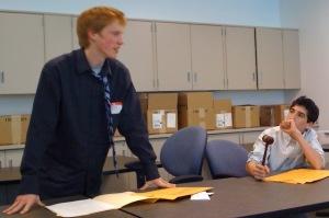 Brandon Edelson (right) listens as AJ Green argues.