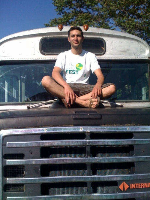 Glenn Friedman poses on the hood of his school bus. He's converting it into a completely sustainable vehicle, using green technology and his own ingenuity.