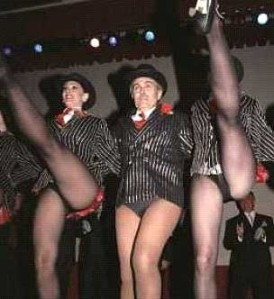 Rudy Giuliani (center) performing some of his mayoral duties.
