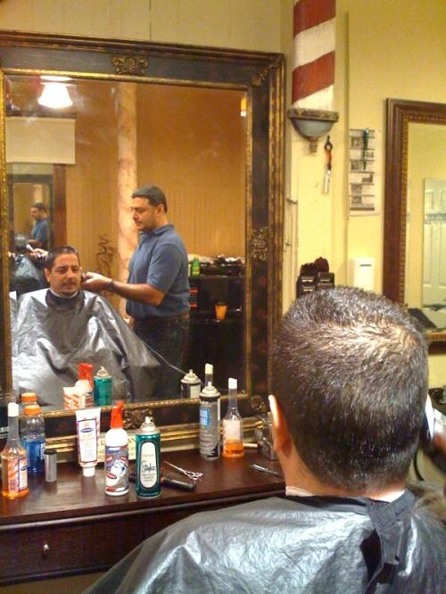 Ron Provenzano trims -- and talks with -- Giovanni Iaffaldano.