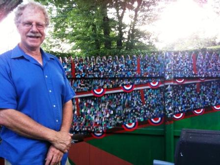 Doc Davidson stands in front of his mural.  Yes, those are all individual fans.