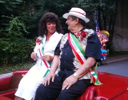 Festival director Roberta Troy and grand marshal Buck Iannacone exchange glances during the parade.