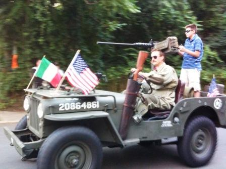 More guns!  This parade vehicle proudly flies the American and Italian flags.