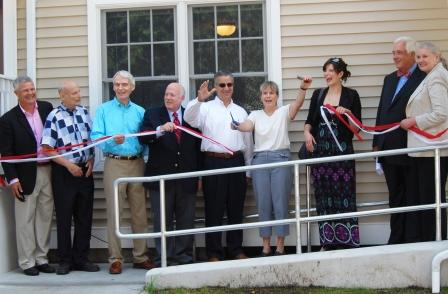 Rotarians and town officials cut the ribbon at the Homes With Hope opening ceremony. (Photo by Dense McLaughlin)