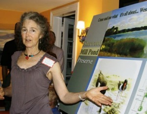 Sherry Jagerson, 191 Hillspoint Road Committee chair, points to Audubon artist Edward Henrey's work.