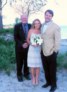 Saul Haffner (left) and a newly married couple on Compo Beach