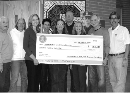 The Class of '69 committee (from left) presents a $1,969 check: Alex Shook, Kathy Kopp Sabo, Peggy Kamins (Staples Tuition Grants), Lorrie Besser Ward, Shelby Goodlett Pike, Mark Bunger, Debbie Hooper Fisher, Jeff Allen, Peter Krieg.  The copy is unidentified.  Missing:  Leslie O'Toole, Karin Swan Brooks, Debbie Sims, Ray Flanigan, Joel Wald.
