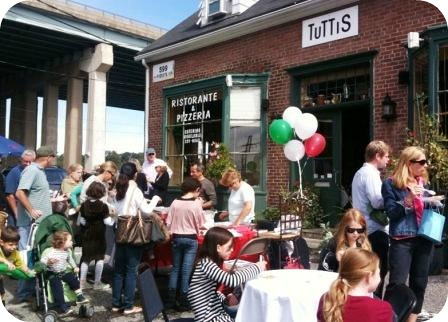 Tutti's parking lot was filled during the Slice of Saugatuck. The restaurant is an important part of the neighborhood.