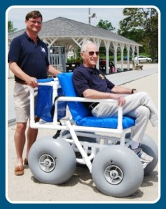 When the beach wheelchair was delivered 10 years ago, then-Parks & Rec director Stuart McCarthy gave Rotary president Irwin Lebish a ride.
