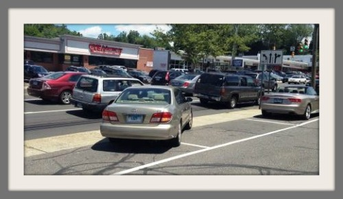 A typical, law-abiding Connecticut driver carefully  merges onto a main road, via the sidewalk.