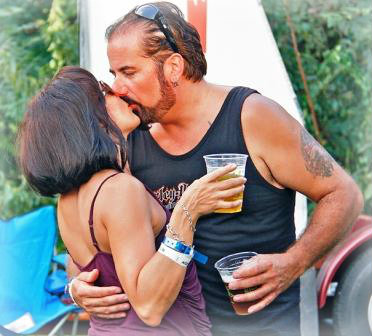 This couple was VERY happy to be at the Blues, Views & BBQ Festival. (Photo/Lynn U. Miller)