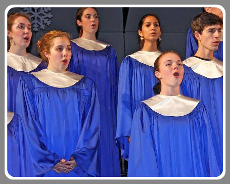 "The Staples Choir's rendition of ""Holy Night, Silent Night"" was hauntingly beautiful. (Photo by Lynn U. Miller)"