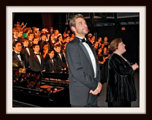 New choral director Luke Rosenberg and veteran orchestra conductor Adele Valovich take bows after last night's Candlelight Concert. Nick Mariconda's band also played magnificently. (Photo by Lynn U. Miller)