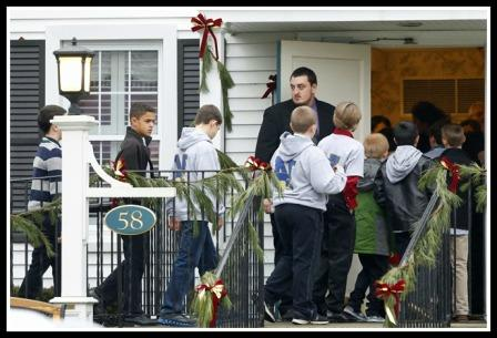 Young boys enter the Honan Funeral Home yesterday, for the funeral of 6-year-old Jack Pinto..