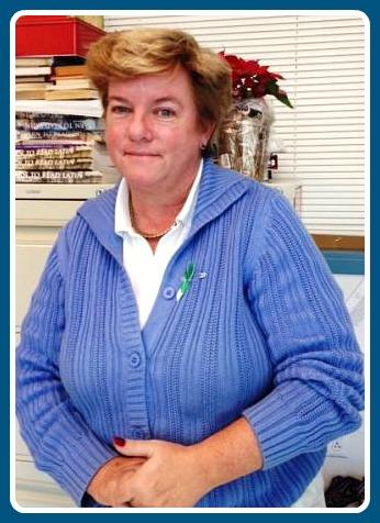 Jennifer Huettner. Her green ribbon honors Sandy Hook Elementary School.