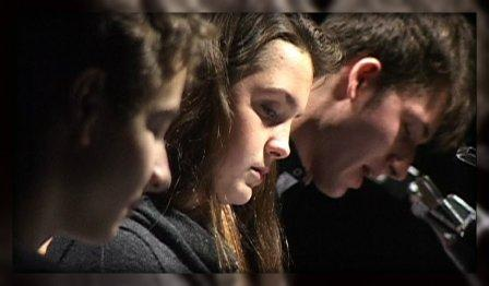 "Will Haskell, Keleigh Brockman and Bryan Gannon intently perform ""It's a Wonderful Life."""