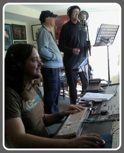 "Michael Mugrage (center) and Charlie Karp (right) record ""The Minister of D,"" with sound engineer Tom Hawes."