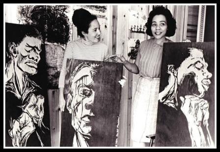 Artist Roe Harper (left) presents Coretta Scott King with civil rights-themed wood carvings.