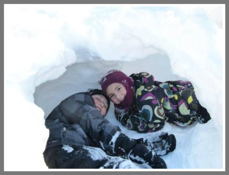 Ethan and Molly Frank find fun in a snow fort.