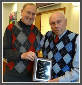 Bill Meyer (right) receives a Lifetime Achievement Award from Senior Center president (and fellow RTM member) Jack Klinge. The event was a Super Bowl party -- one of the countless projects Bill organized. (Photo by Mike Lauterborn./Westport News)