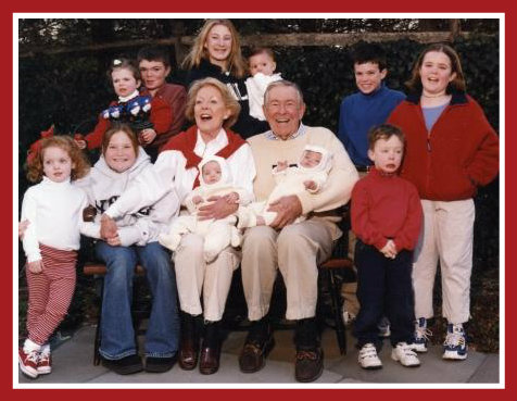 Mike and Andy Pettee, surrounded by their 11 grandchildren.