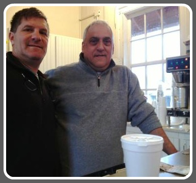 "George Russo (right) with ""loyal customer Joe."""