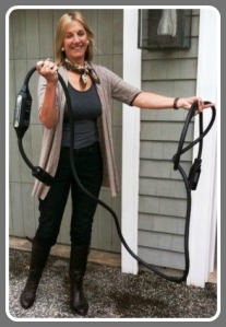 "Robin Tauck, with her Tesla battery charging cord. She drives back and forth to New York often, she says, with ""no range anxiety."""