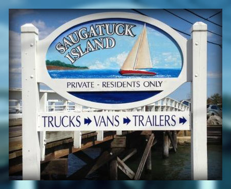 Harbor Road continues over a canal. This handsome sign marks the entrance to Saugatuck Island.