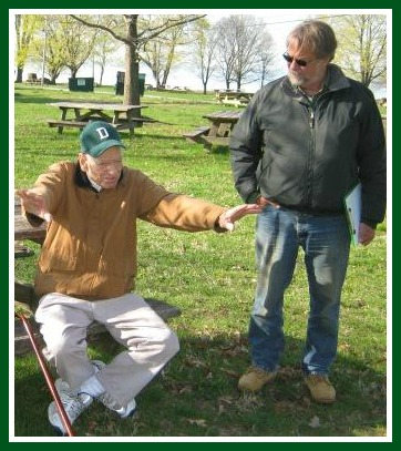In preparation for Wednesday's event, Elwood Betts (left) shows archaeologist Ernie Wiegand where the 1787 Sherwood house stood.