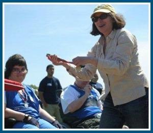 Helen Garten, awarding medals at a Special Olympics event.