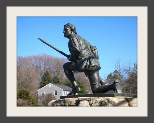 The Minuteman statue. In the distance is Minuteman Hill.