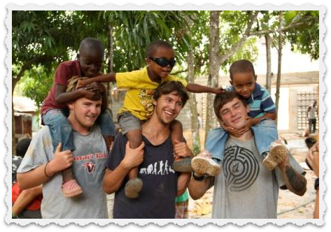 Alec Andrews (left), 2 Ocean Classroom friends, and 3 orphans in Santo Domingo.
