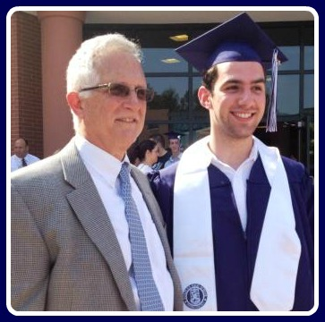 At graduation, many students ask to pose for photos with their principal. In 2013, John Dodig stood with departing senior August Laska.