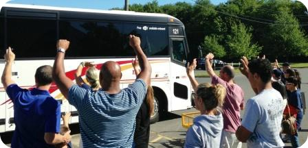 Parents and friends cheer the Westport Little League all-stars' bus.