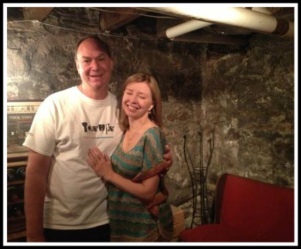 Steve Ruchefsky and Rondi Charleston in their wine cellar. The bench comes from Westport Country Playhouse.