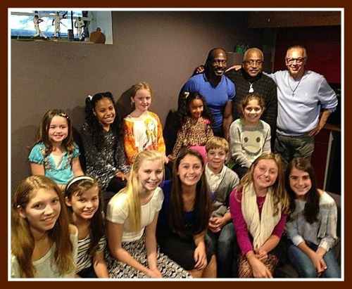 The children's chorus, Dodie Petit, Curtis King and the producers.