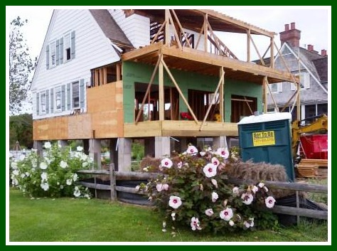 This Island Way home was in mid-elevation, with the 1st floor stripped back to studs, before being placed on a new, higher foundation.  (Photo/William Adler)
