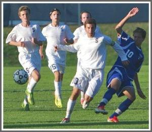 Diego Alanis (front) and Michael  Reid, Jack Scott and Charlie Leonard play swarming soccer. (Photo/Kim Lake)