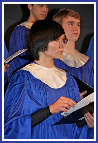 """The a cappella choir's selections ranged from """"Schindler's List"""" and """"Carol of the Bells"""" to """"Deck the Halls."""" (Photo/Lynn U. Miller)"""