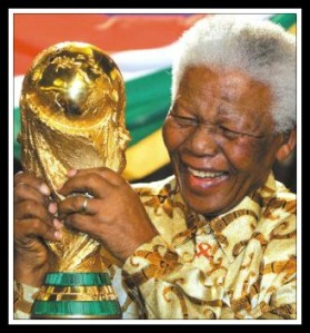 Nelson Mandela, with the World Cup trophy. Partly in recognition of his efforts at uniting the country, South Africa was named host  of the 2010 tournament.