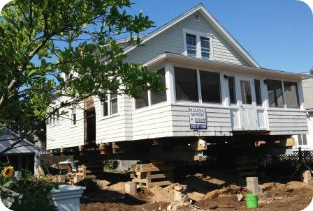 Individual homeowners have paid hundreds of thousands of dollars to raise homes at Compo Beach...