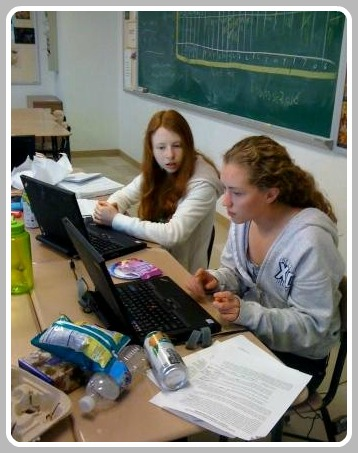 In 2010, Emily Cooper and Rachel Myers used laptops and food to help make Westport a greener community. (Photo/Julia McNamee)