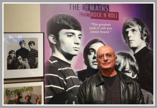 In January, Chip Damiani attended the Fairfield History Museum's opening reception for its rock 'n' roll exhibit. He posed in front of posters of his legendary band, the Reamins.