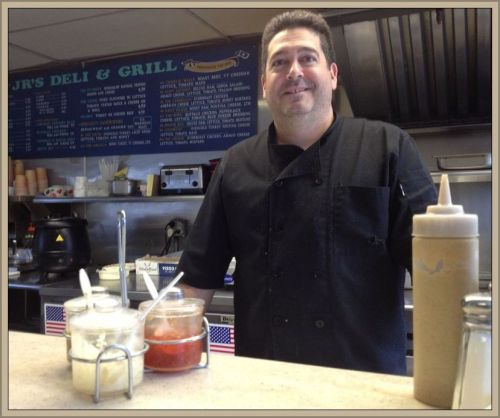 Jeff Arciola, at his familiar spot behind Jr's counter.
