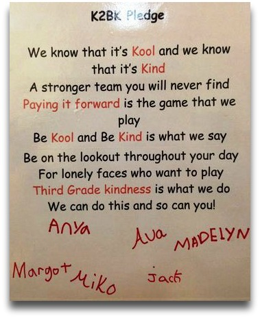 "A ""be kind"" pledge, signed by 3rd graders and their Staples counterparts."