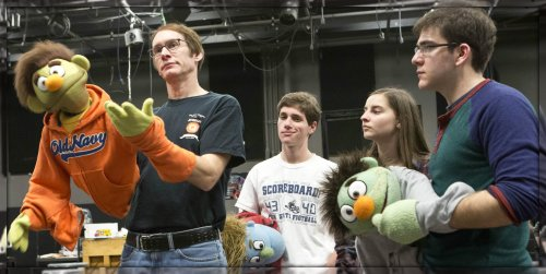 Rick Lyon (left) coaches Caroline Didelot and Everett Sussman (right), one of the team of student puppeteers playing Nicky. (Photo/Kerry Long)