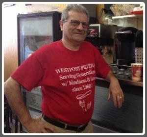 "Westport Pizzeria owner Mel Mioli. His shirt says, ""Serving generations with kindness and love since 1968!"""