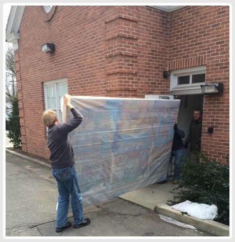 Last Thursday, the mural was removed from the old bank building.