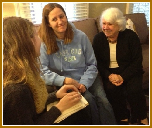 Eliza (left) relaxes with her sketch notebook in the Project Return living room with Christine Manenke (transitional living coordinator) and Susie Basler (executive director).