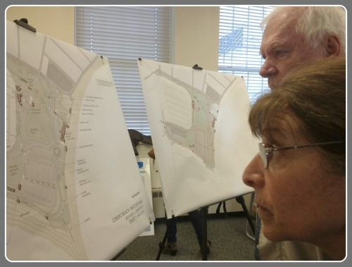 Early arrivals examined a proposed Compo Beach site plan, before today's meeting.